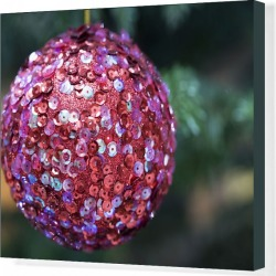 Canvas Print. Sparkling, sequined bauble suspended from Christmas tree branch