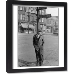 Framed Print. CHICAGO, 1941. Man standing at the corner of State and 44th Streets in Chicago, Illinois