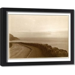 Framed Print. Coastal view with empty road, North Wales