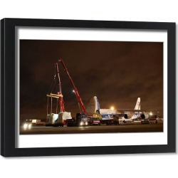 Framed Print. Volga Dnepr Airlines delivering oil and gas equipment f