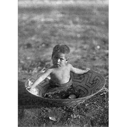 Jigsaw Puzzle. CURTIS: MARICOPA CHILD. A Maricopa Native American child sitting in a basket in