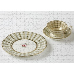 Jigsaw Puzzle. Plate, teacup and saucer