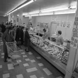 Photographic Print: The Meat Counter at the Asda Supermarket in Rotherham, South Yorkshire, 1969 by Michael Walters: 16x16in