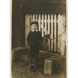 Poster: A Young Boy Poses with His Pet Dog, Probably a Whippet, by a G