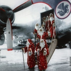 Photo Print: Ten Santa Claus Deplaning December 15, 1953. Colorized Do